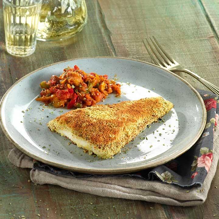 Filetes de merluza provenzal con salteado de pimientos