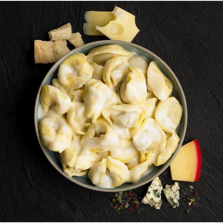 Capelletti con setas y salsa 4 quesos